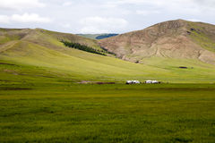 Gers on the Steppes. Three bright white gets or yurts rest on the gentle slopes of the steppes Stock Photography