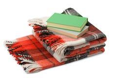 Geruite deken en boeken Royalty-vrije Stock Fotografie