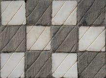 Geruite grijze en witte steentextuur royalty-vrije stock afbeelding