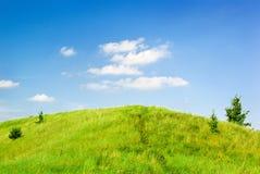 Gesättigter grüner Hügel lizenzfreies stockbild
