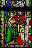 Gesù a San Tommaso: Smetta di dubitare, ma credi - Glas macchiato fotografia stock libera da diritti