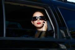 Geschäft in der Limousine Stockfoto