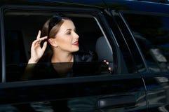 Geschäft in der Limousine Stockbild