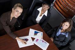 Geschäft mit drei Frauen Stockbild