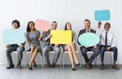 Geschäft Team Speech Bubble Holding Concept Stockbild
