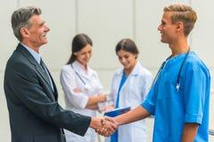 Geschäft u. Medizin lizenzfreies stockbild