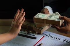 Geschäft und Bestechung lizenzfreie stockfotos