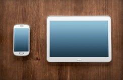 Geschäfts-Arbeit mit Tablet u. Smartphone Stockfoto