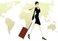 Geschäfts-Dame im Schwarzen mit einer Gepäckreise Stockfoto