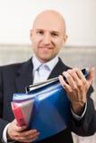 Geschäfts-Papierarchive in der Hand Stockbilder