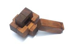 Geschäfts-Teamwork-Konzept: Hölzerner Brain Teaser oder hölzerne Puzzlespiele Lizenzfreie Stockfotografie