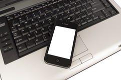 Geschäfts-Telefon auf Laptop-Computer XXXL Lizenzfreie Stockfotografie