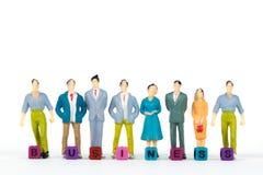 GESCHÄFTS-Text und Gruppe oder Zahl Miniaturgeschäftsmann von kleinem Stockfoto