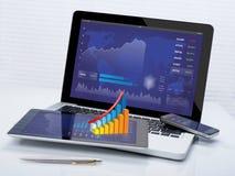 Geschäftsaktien auf tragbaren Geräten Stockfotos