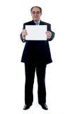 Geschäftsberufsholding-Leerzeichenanschlagtafel lizenzfreie stockbilder
