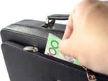 Geschäftsbeutel und -geld Stockfotografie