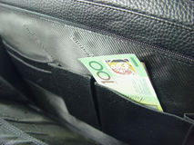 Geschäftsbeutel und -geld Stockbilder