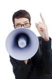 Geschäftsdame, die zum Lautsprecher schreit Stockfotos