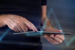 Geschäftsdiagramm auf digitalem Tablet-Computer Stockbilder