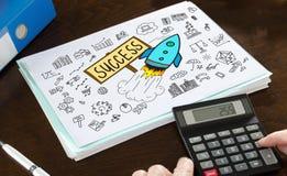 GeschäftserfolgKonzept veranschaulicht auf einem Papier Stockfotografie