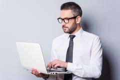 Geschäftsexperte bei der Arbeit Lizenzfreie Stockfotos