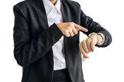 Geschäftsfrau überprüft Zeit auf ihrer Armbanduhr, Zeit, das späte Konzept, lokalisiert auf weißem Hintergrund Stockbilder