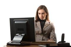 Geschäftsfrau auf dem Arbeitsplatz Stockbild