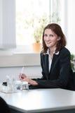 Geschäftsfrau auf einer Sitzung Stockbilder