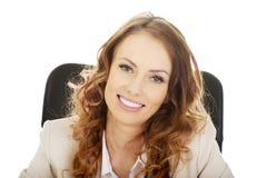 Geschäftsfrau auf Lehnsessel Stockfotografie