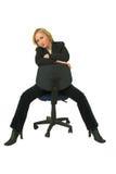 Geschäftsfrau auf Stuhl Lizenzfreie Stockfotos