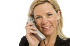 Geschäftsfrau benutzt Telefon Stockbild