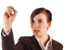 Geschäftsfrau in der braunen Klage mit Bleistift Stockfotografie