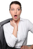 Geschäftsfrau, die überrascht schaut Stockfotografie