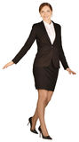 Geschäftsfrau, die auf einem Bein und Schauen steht Stockbild