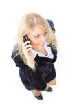 Geschäftsfrau, die auf Handy spricht Stockbilder