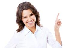 Geschäftsfrau, die auf weißen Hintergrund zeigt Stockfoto