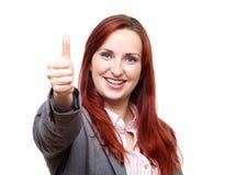 Geschäftsfrau, die Daumen aufgibt stockbild