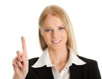 Geschäftsfrau, die den Bildschirm mit ihrem Finger berührt Lizenzfreie Stockfotos