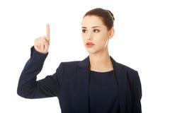 Geschäftsfrau, die durch einen Finger zeigt Stockbild