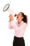 Geschäftsfrau, die durch Megaphon schreit Lizenzfreies Stockfoto
