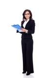 Geschäftsfrau, die ein Klemmbrett anhält Stockfotos