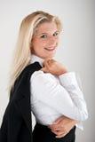Geschäftsfrau, die eine Jacke anhält Lizenzfreie Stockfotografie
