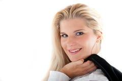 Geschäftsfrau, die eine Jacke anhält Lizenzfreies Stockbild
