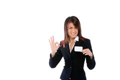 Geschäftsfrau, die eine Karte mit O.K. schiebt Stockbild