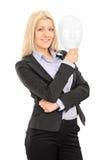 Geschäftsfrau, die eine Theatermaske hält Lizenzfreies Stockbild