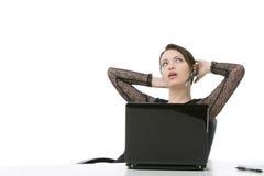 Geschäftsfrau, die einen Kopfhörer trägt Lizenzfreie Stockfotografie