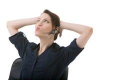 Geschäftsfrau, die einen Kopfhörer trägt Stockfotos