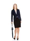 Geschäftsfrau, die einen Regenschirm hält Lizenzfreie Stockbilder