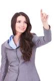 Geschäftsfrau, die eingebildeten Bildschirm drückt Lizenzfreie Stockfotos