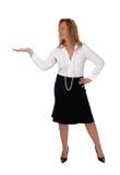 Geschäftsfrau, die etwas anbietet Lizenzfreie Stockfotografie